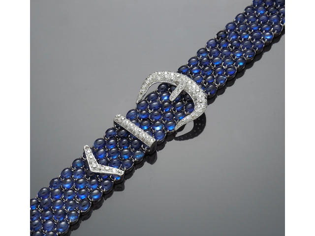 A cabochon sapphire and diamond buckle style bracelet