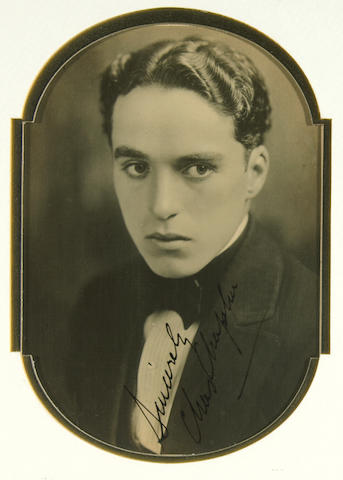 A Charlie Chaplin signed black and white photograph