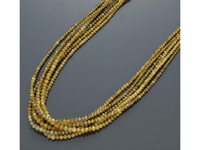 A colored diamond and diamond multi-strand necklace