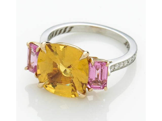 A yellow sapphire, pink sapphire and diamond ring