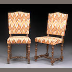 A set of twelve Italian Baroque style walnut dining chairs