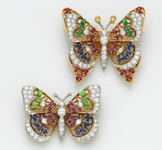 A pair of gem-set, diamond and colored diamond butterfly brooches