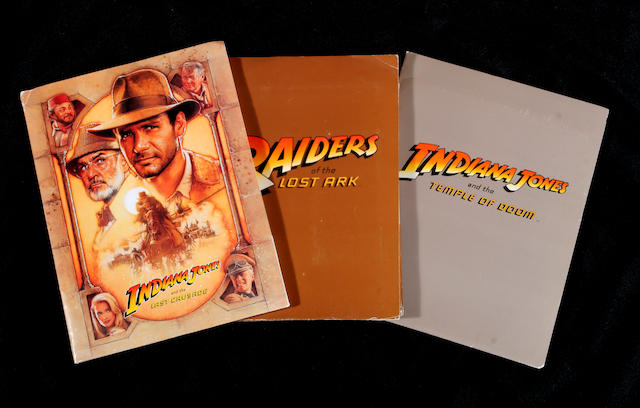 "A group of original press kits from the three ""Indiana Jones"" films"