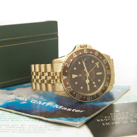 Rolex. A fine 18k gold self-winding dual time-zone bracelet watch with presentation case Oyster Perpetual GMT Master, Ref.1675, Case No.2611114, made in 1969