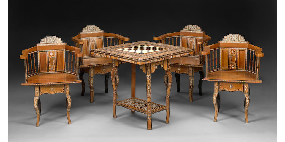 A Levantine parquetry inlaid games table with four matching chairs