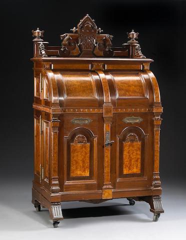 A Wooton Renaissance Revival walnut and birdseye maple 'extra grade' cabinet secretary