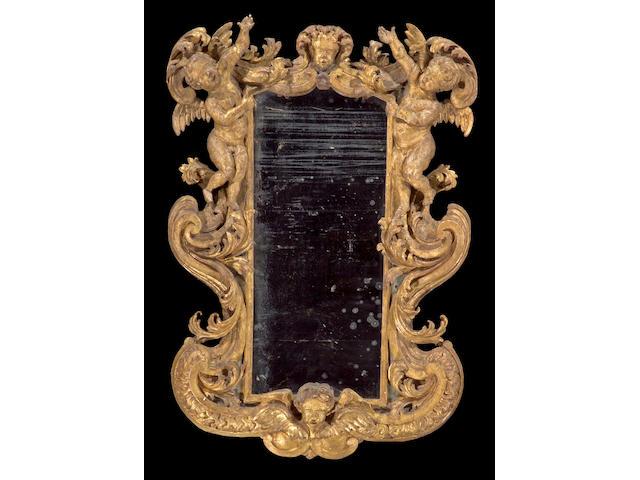 An Italian or Spanish Rococo giltwood mirror