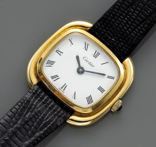 An eighteen karat gold wristwatch with black leather strap, Cartier