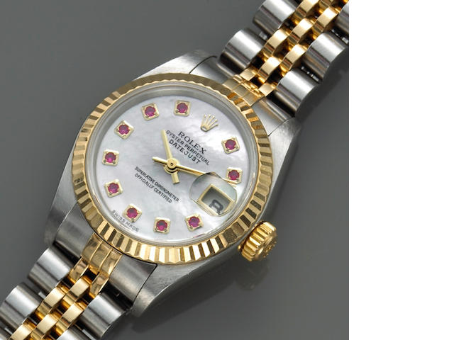 Rolex. A ladies stainless steel and gold self-winding calendar bracelet watch with ruby-set mother-of-pearl dial DateJust, Ref.79173, Made circa 2003