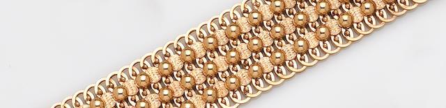 A fourteen karat wide gold bracelet