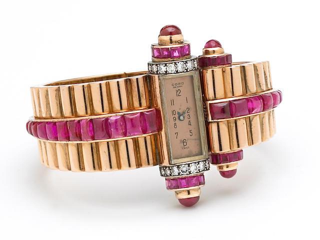 A retro ruby and gold bangle wristwatch,