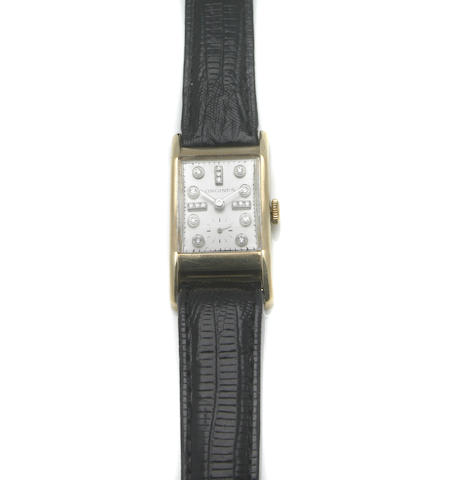 Longines. A mid-size 14k gold rectangular wristwatch with diamond set markers 1930s