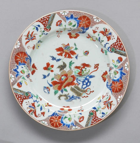 A gilt and polychrome enameled export porcelain dish Late Kangxi Period