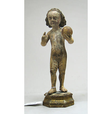 A European carved, polychrome, and parcel gilt figure of the infant Christ