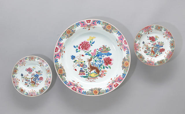 A well-painted export porcelain deep charger and two soup plates with famille rose decoration  18th