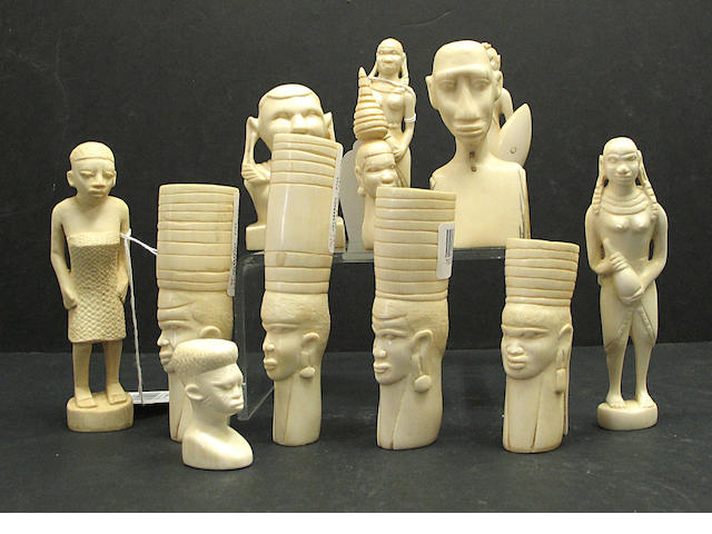 An assembled group of fifteen African carved ivory figures