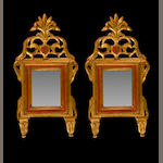 A pair of Italian Neoclassical style painted and parcel gilt mirrors