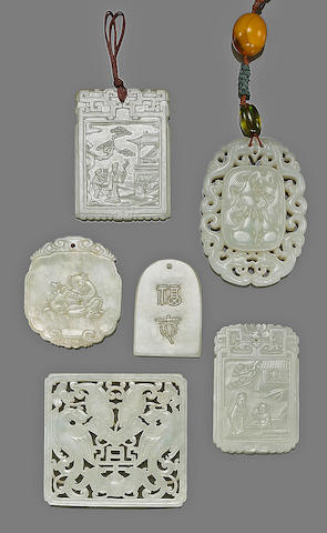 A group of six jade pendants