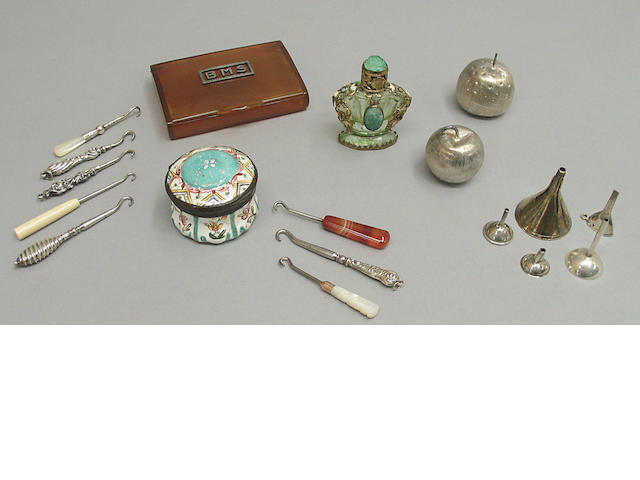 An assembled grouping of and silver dressing articles and various small boxes