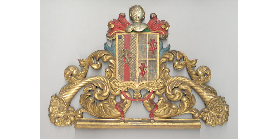 An Iberian Baroque style carved gilt and polychrome wood armorial pediment