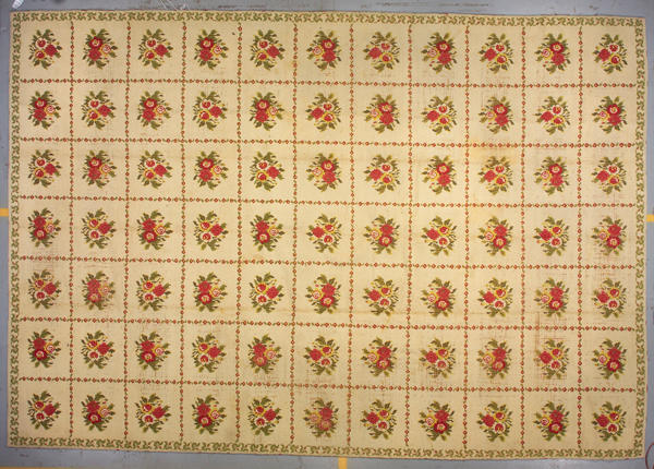 A European needlepoint carpet  size approximately 12ft. x 17ft. 8in.