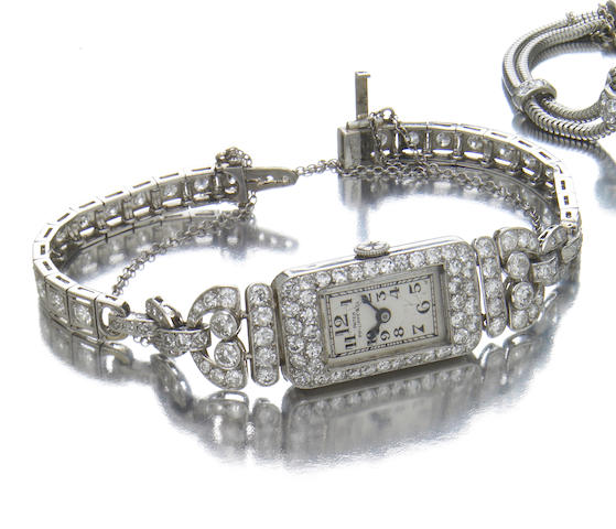 Patek Philippe & Co., A ladies platinum and diamond set cocktail watch on associated platinum and diamond set braceletMovement No.815'104, made circa 1928