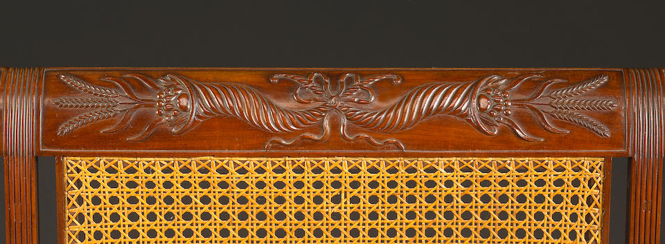 A very fine and important Federal carved mahogany settee