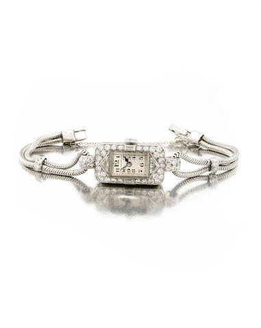 Patek Philippe & Co., A ladies platinum and diamond set cocktail watch on platinum braceletMovement No.817'332, made circa 1928