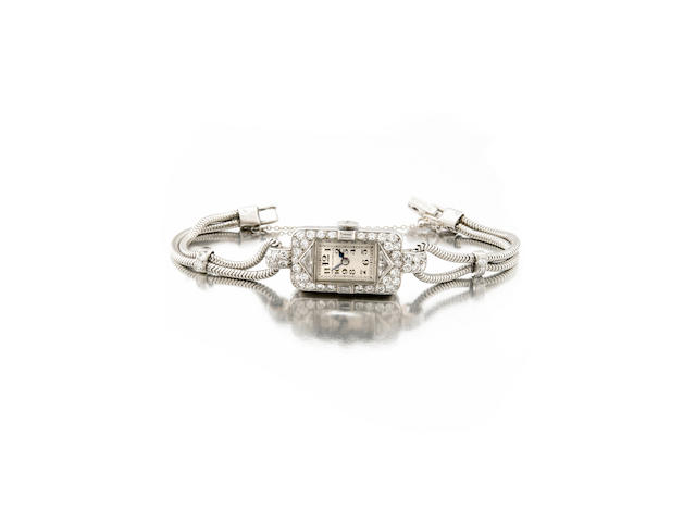 Patek Philippe & Co., A ladies platinum and diamond set cocktail watch on platinum braceletMovement No.817'332, made circa 1928