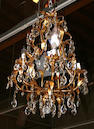 An Italian Rococo style parcel gilt and cut glass six light chandelier