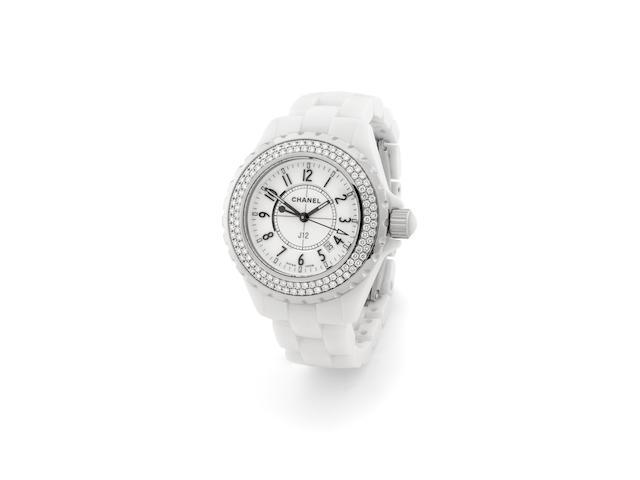 Chanel. A white ceramic, steel and diamond set mid-size quartz calendar bracelet watchJ12, circa 2006