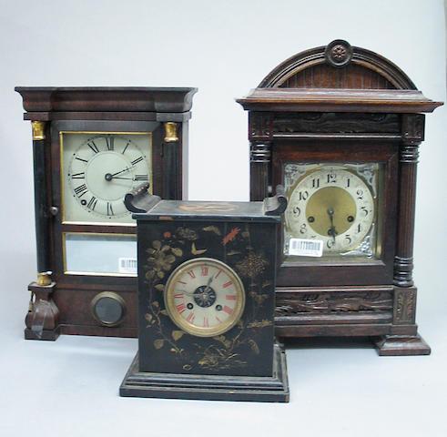 A group of three mantel clocks
