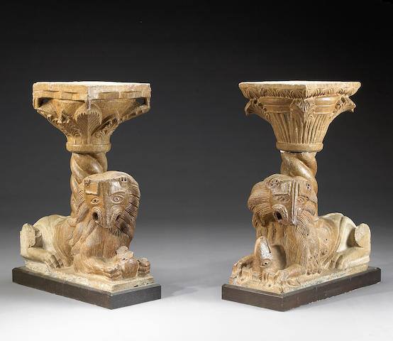 A pair of Italian Romanesque style marble recumbant lion columns and capitals in the 12th century taste