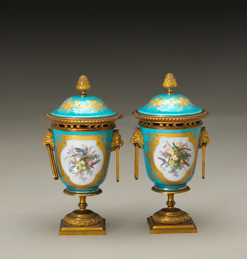 A pair of Napoleon III Sèvres style porcelain gilt bronze mounted covered urns
