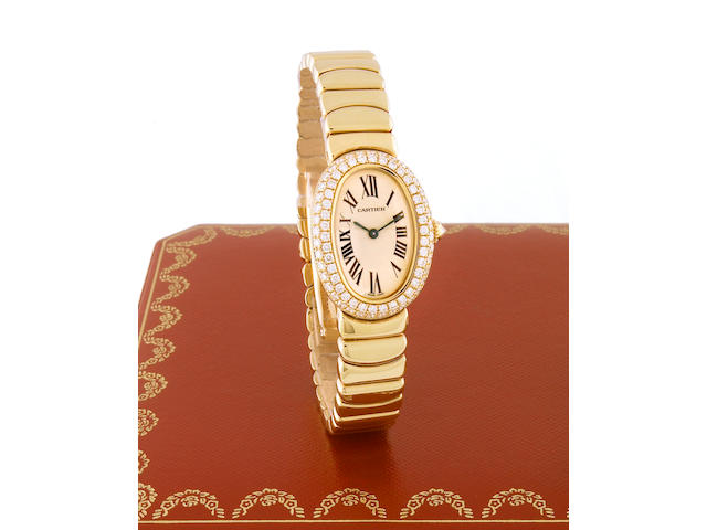 Cartier. A Ladies 18k gold and diamond set oval cased quartz bracelet watch Baignoire, recent