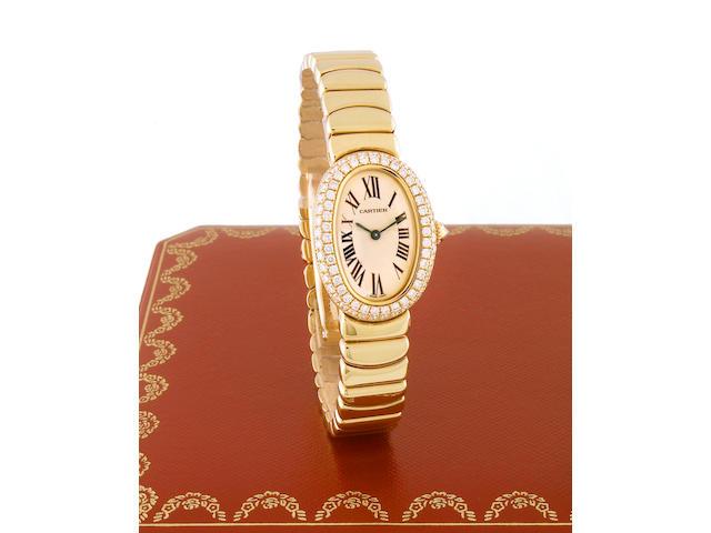 Cartier. A Ladies 18k gold and diamond set oval cased quartz bracelet watchBaignoire, recent