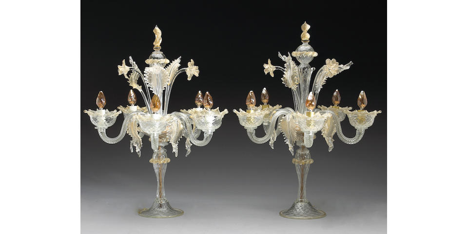 A pair of Murano gold flecked colorless glass five light candelabra