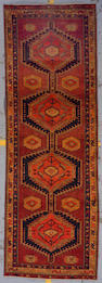 A Kurdish runner size approximately 3ft. 6in. x 10ft. 6in.