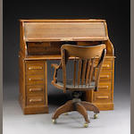 An American oak rolltop desk together with a swivel chair