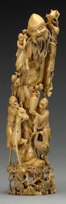 A carved and tinted ivory figure of Shoulao and children 20th Century