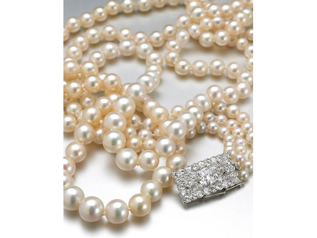 An impressive three-row natural pearl and diamond necklace, mounted by Cartier,