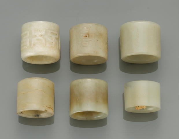 A group of six jade and hardstone archiastic rings