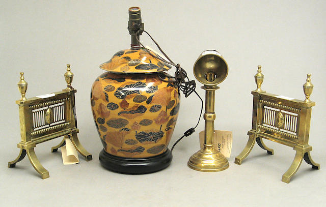 A grouping of a ceramic table lamp, brass desk lamp and pair of brass andirons (now as bookends)