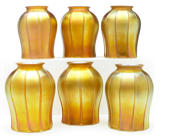 A group of six Quezal gold iridescent ribbed glass floriform shades
