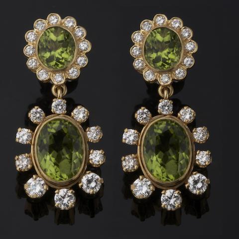 A pair of peridot and diamond earrings