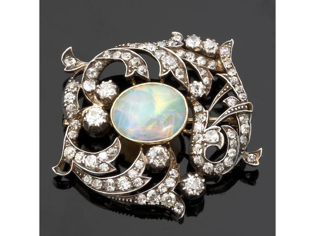 An opal and diamond brooch,