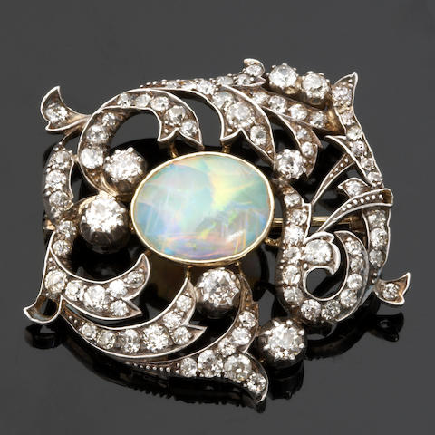An opal and diamond brooch,