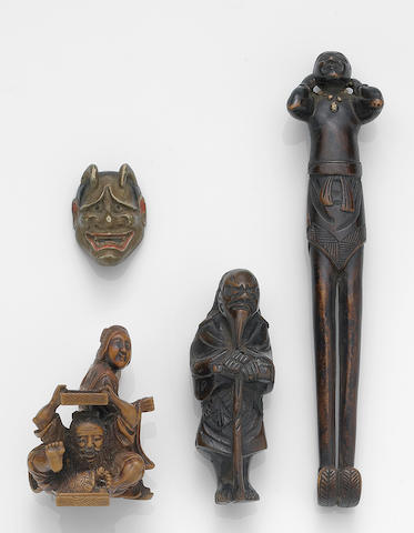 Four small wood carvings