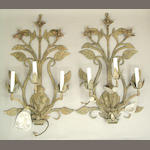 A pair of tôle and rock crystal three light sconces