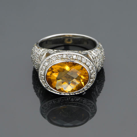 A diamond and citrine ring